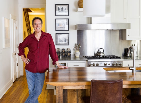 Architect Chris Kepes standing in renovated kitchen